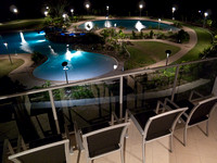 Bluewater Lagoon and balcony of Rivage 35 at night