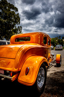 2994 - octane '32 Ford coupe with storm clouds closeup from behind